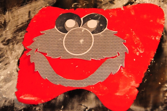 Elmo cake with a rainbow cake surprise inside balancing for Elmo template for cake