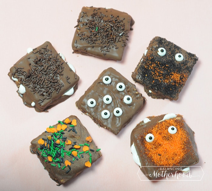 chocolate-covered smores with monster eyes