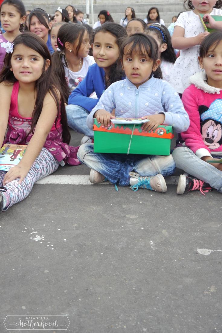 Kids sitting on the ground